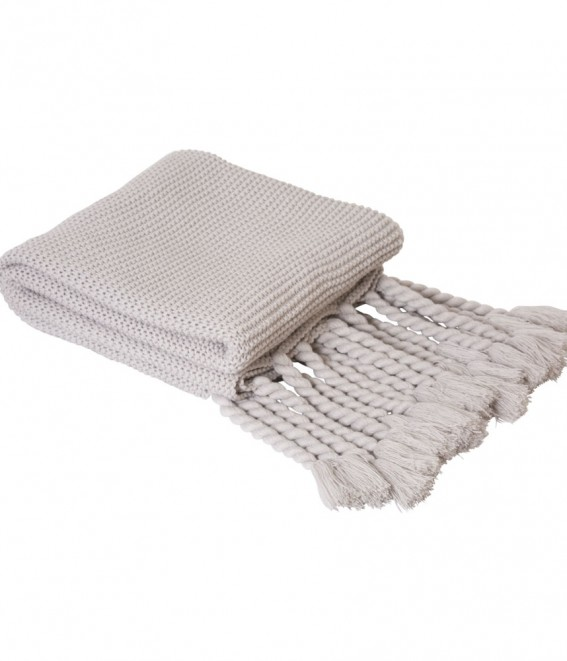 Twig-and-feather-grey-knitted-throw-with-tassels